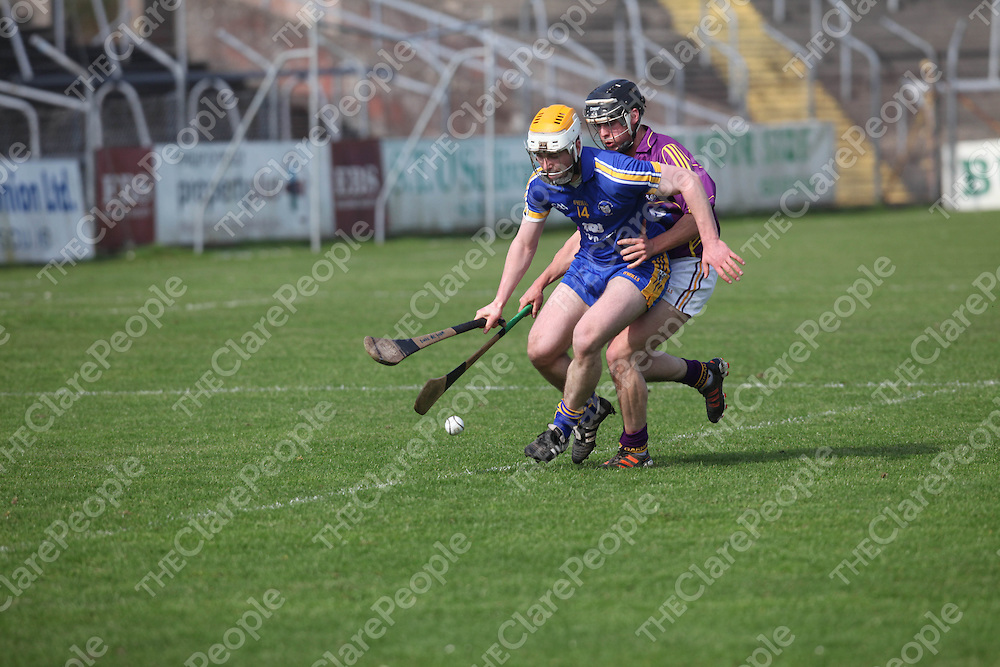 Clare's Conor McGrath and Wexfords James Tonks in action in Cusack Park on Sunday.<br /> Pic. Brian Arthur/ Press 22.
