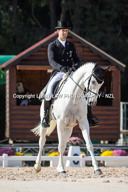 NZL-Jonathan Paget (SHADY GREY) INTERIM-=11TH: CCI4* DAY TWO OF DRESSAGE: 2014 FRA-Les Etoiles de Pau (Friday 24 October) CREDIT: Libby Law COPYRIGHT: LIBBY LAW PHOTOGRAPHY - NZL