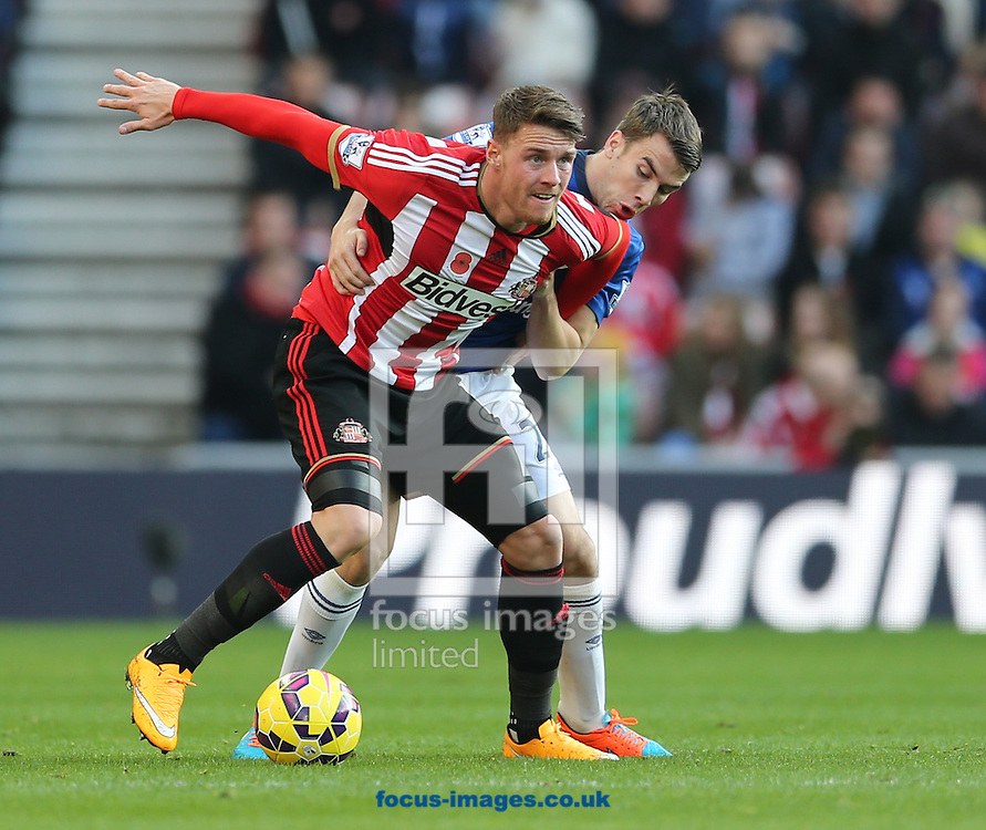 Connor Wickham of Sunderland holds off Seamus Coleman of Everton during the Barclays Premier League match at the Stadium Of Light, Sunderland<br /> Picture by Simon Moore/Focus Images Ltd 07807 671782<br /> 09/11/2014