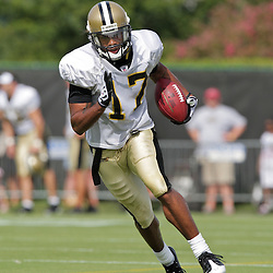 31 July 2009: New Orleans Saints wide receiver Robert Meachem (17) runs with the ball during receiving drills on the opening day of New Orleans Saints training camp held at the team's practice facility in Metairie, Louisiana.