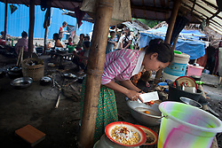 A Kachin woman cook the dinner in Woi Chyai Internal Displacement People refugee camp in Laiza village close to the China border, Myanmar on July 13, 2012. According to KIO (Kachin Independence Organization) sources around 50000 Kachin people live as refugees in those camps.