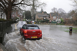 © Licensed to London News Pictures. 5/02/2014<br /> Wet and windy weather conditions continue across the UK. <br /> The river Darent in Eynsford,Kent  has risen to 3 feet at the Eynsford ford flooding the road and fields.<br /> Photo credit :Grant Falvey/LNP