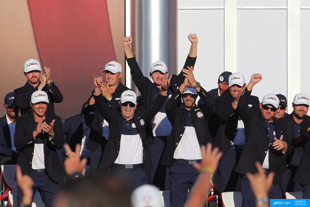 Ryder Cup 2016. Day Three. The United States team salute their caddies during presentation at the Ryder Cup tournament at Hazeltine National Golf Club on October 02, 2016 in Chaska, Minnesota.  (Photo by Tim Clayton/Corbis via Getty Images)