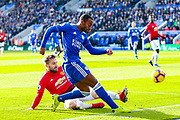 Leicester City Defender Ricardo Pereira (14) tackled by Manchester United Defender Luke Shaw (23) during the Premier League match between Leicester City and Manchester United at the King Power Stadium, Leicester, England on 3 February 2019.