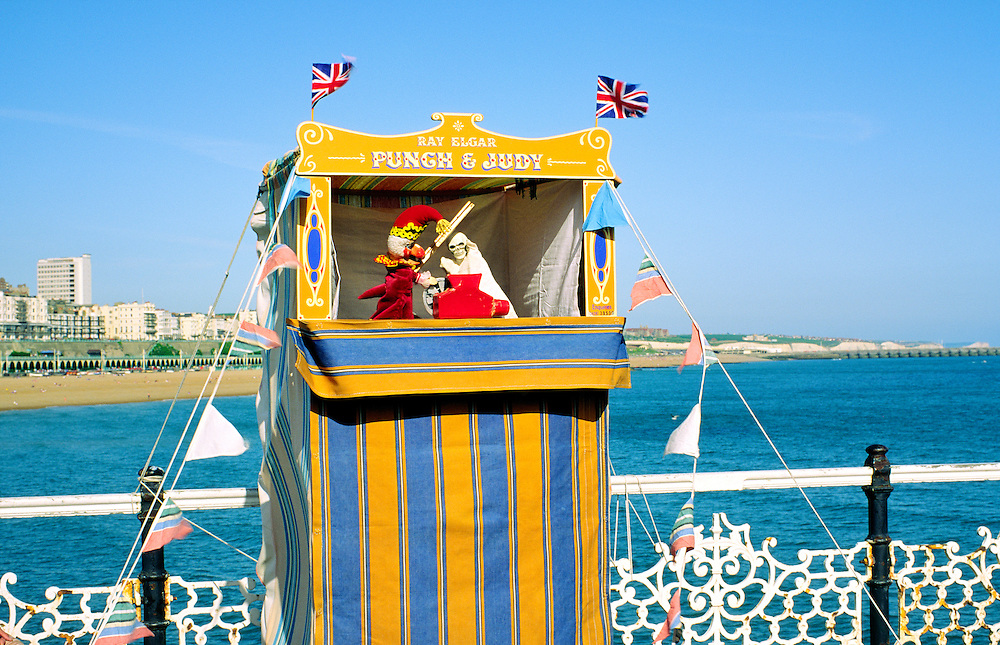 Punch and Judy show theatre on Brighton Pier in the south coast English Channel seaside resort of Brighton, England.