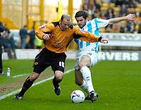 Photo: Ed Godden.<br />Wolverhampton Wanderers v Brighton & Hove Albion. Coca Cola Championship. 22/04/2006. Colin Cameron (L) is challenged by Brighton's Alex Frutos.