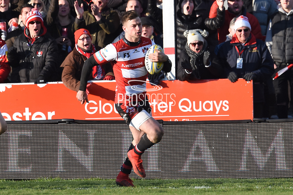 Gloucester winger / centre Henry Trinder runs to score a try during the Aviva Premiership match between Gloucester Rugby and Wasps at the Kingsholm Stadium, Gloucester, United Kingdom on 24 February 2018. Picture by Alan Franklin.