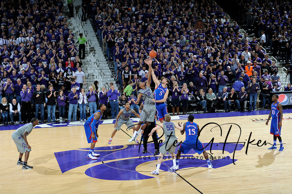 MANHATTAN, KS - FEBRUARY 13:  The opening tip-off between the Kansas Jayhawks and the Kansas State Wildcats on February 13, 2012 at Bramlage Coliseum in Manhattan, Kansas.  (Photo by Peter G. Aiken/Getty Images) *** Local Caption ***