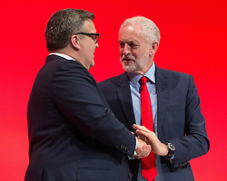 © Licensed to London News Pictures . 27/09/2016 . Liverpool , UK . TOM WATSON shakes hands with JEREMY CORBYN after delivering the deputy leader's speech on the third day of the Labour Party Conference . Photo credit : Joel Goodman/LNP