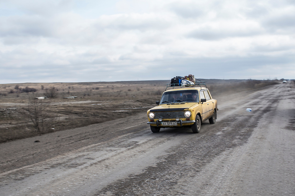 A car with civilians and their belongings drives away from the town of Debaltseve, scene of heavy fighting recently, on February 8, 2015 in Svitlodarsk, Ukraine. Fighting between pro-Russia rebels and Ukrainian forces has dealt steady casualties to Ukrainian fighters and civilians.