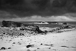 Snowstorm at Dyrholaey, south coast of Iceland - snjór og brim við Dyrhólaey