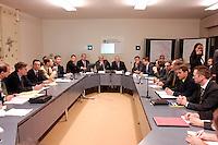 01 DEC 2005, BERLIN/GERMANY:<br /> Frank-Walter Steinmeier (Mi-L), SPD, Bundesaussenminister, und Dr. Klaus Scharioth (Mi-R), Staatssekretaer im Auswaertigen Amt, und Mitarbeiter des Amtes, zu Beginn einer Sitzung des Krisenstabes, in den Raeumen des aufgrund der Geiselname einer Bundesbuergerin im Irak aktivierten Krisenreaktionszentrums, Auswaertiges Amt<br /> IMAGE: 20051201-01-014<br /> KEYWORDS: Krisenzentrum, Krisenstab, Saal, Sitzungssaal, Übersicht, Ueberscht
