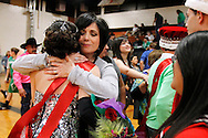 Anabel Navarro gives her daughter, Premont senior Mariela Navarro, a hug after Mariela was crowned Homecoming Princess Feb. 1, 2013 in Premont, Texas. Anabel Navarro said she was also crowned Homecoming Princess when she was a student at Premont High School.
