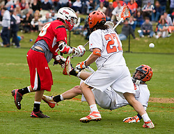 Virginia Cavaliers A Danny Glading (9) is knocked down by Maryland Terrapins Attack Joe Cummings (19).  The #9 ranked Maryland Terrapins fell to the #1 ranked Virginia Cavaliers 10 in 7 overtimes in Men's NCAA Lacrosse at Klockner Stadium on the Grounds of the University of Virginia in Charlottesville, VA on March 28, 2009.