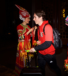 NANNING, CHINA - Monday, March 19, 2018: Wales' Harry Wilson is welcomed by women in traditional costume as the team arrive at the Wanda Realm Resort in Nanning for the 2018 Gree China Cup International Football Championship. (Pic by David Rawcliffe/Propaganda)