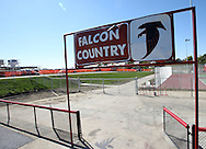 A Falcon Country sign sits over the entrance to the Aplington-Parkersburg football field in Parkersburg, Iowa on October 3, 2008. The sign was damaged by the tornado that destroyed the high school. The new high school is under construction in the background. (Stephen Mally / Special to The Denver Post)