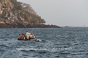 Tourists on an inflatable raft tour the sea bird colonies on Bona Island, located in the Panama Bay.