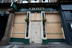 Glasgow, Scotland, UK. 26 March, 2020. Views from city centre in Glasgow on Thursday during the third day of the Government sanctioned Covid-19 lockdown. The city is largely deserted. Only food and convenience stores open. Pictured; Bar closed and boarded up. Iain Masterton/Alamy Live News