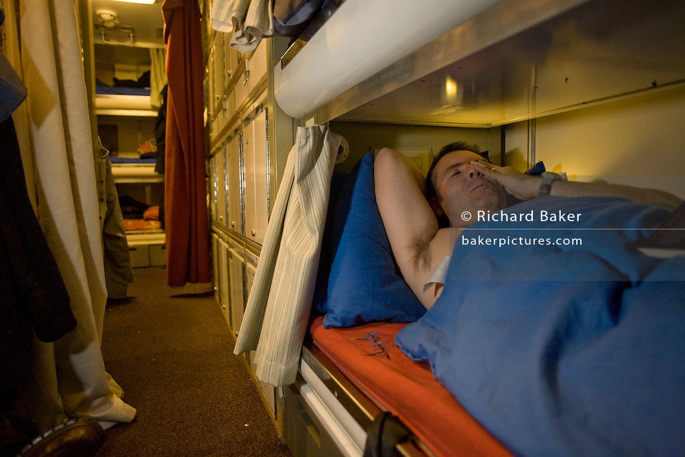 Able-bodied sailor relaxes in his Junior Rating bunk aboard HMS Vigilant, a Vanguard class nuclear submarine