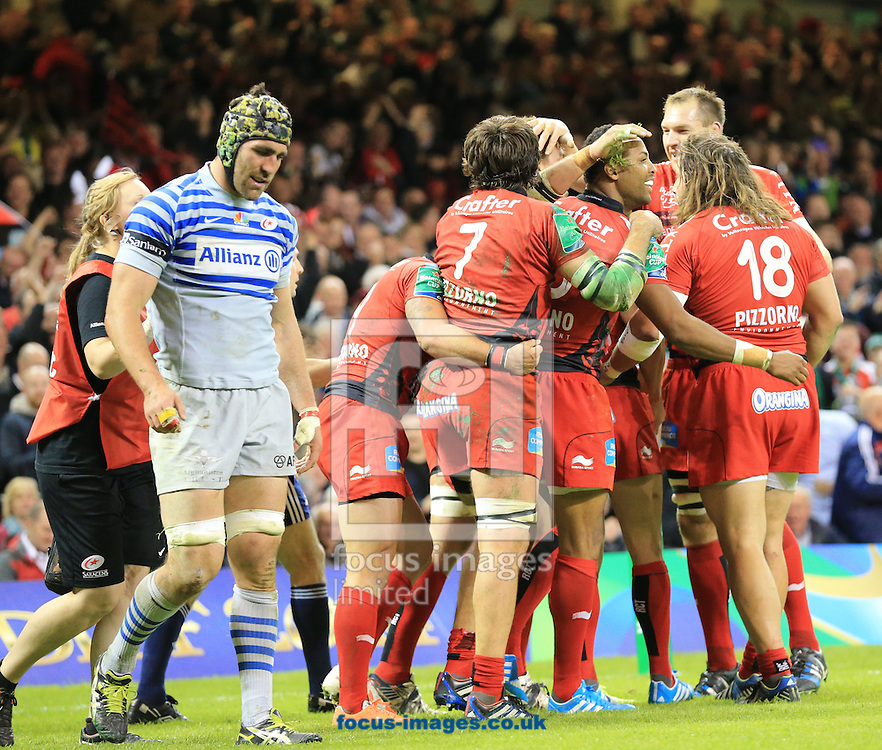 Toulon celebrate as Kelly Brown of Saracens looks dejected during the Heineken Cup Final at the Millennium Stadium, Cardiff<br /> Picture by Michael Whitefoot/Focus Images Ltd 07969 898192<br /> 24/05/2014