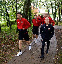 CARDIFF, WALES - Sunday, October 13, 2019: Wales' (L-R) Kieffer Moore, Will Vaulks and physiotherapist Paul Harris during a pre-match team walk at the Vale Resort ahead of the UEFA Euro 2020 Qualifying Group E match between Wales and Croatia. (Pic by David Rawcliffe/Propaganda)