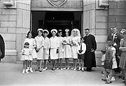 28/07/1962<br /> 07/28/1962<br /> 28 July 1962 <br /> Wedding of Mr Desmond F. English, Landscape Cresent, Churchtown and Miss Blanche O'Brien Oakley Park, Blackrock at St John the Baptist Church, Blackrock and Ross's Hotel Dun Laoghaire, Dublin. Image shows the Bide's group outside the church after the ceremony.