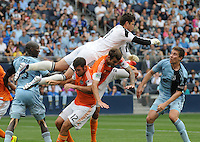 Football - Major League Soccer - Houston Dynamo at Sporting KC - The Sporting KC and the Houston Dynamo played to a 1-1 tie in regulation time at Sporting KC Park in Kansas City, Kansas, USA. Houston Dynamo goalkeeper Tally Hall (1, left) leaps over Houston Dynamo teammates forward Will Bruin (12) and defender Eric Brunner (2) to spike the ball on a corner kick late in the first half.  At far left is Sporting KC defender Ike Opara (3), and at far right is Sporting KC defender Matt Besler (5)..