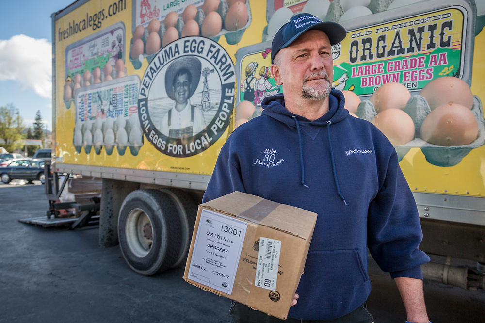 Mike Davis delivers eggs from Petaluma Egg Farm to Sunshine Foods in Saint Helena, CA