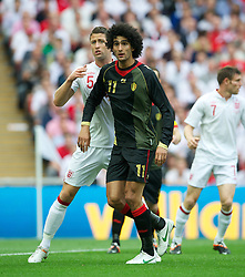 LONDON, ENGLAND - Saturday, June 2, 2012: England's Gary Cahill in action against Belgium's Marouane Fellaini during the International Friendly match at Wembley. (Pic by David Rawcliffe/Propaganda)