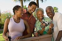 Family Looking at Video Camera at Barbecue
