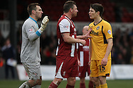 Steve Elliott of Cheltenham Town and Ryan Burge of Newport County &reg;  have a disagreement. Skybet football league 2 match, Newport county v Cheltenham Town at Rodney Parade in Newport, South Wales on Saturday 22nd Feb 2014.<br /> pic by Mark Hawkins, Andrew Orchard sports photography.