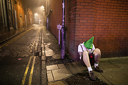 © Licensed to London News Pictures . 27/12/2018. Wigan, UK. Revellers in Wigan enjoy Boxing Day drinks and clubbing in Wigan Wallgate . In recent years a tradition has been established in which people go out wearing fancy-dress costumes on Boxing Day night . Photo credit: Joel Goodman/LNP