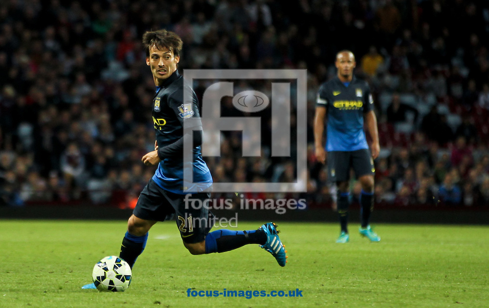 David Silva (left) of Manchester City in possession of the ball during the Barclays Premier League match at Villa Park, Birmingham<br /> Picture by Tom Smith/Focus Images Ltd 07545141164<br /> 04/10/2014
