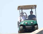 15.JULY.2011. FRANCE<br /> <br /> NICOLAS SARKOZY WITH WIFE CARLA BRUNI-SARKOZY IN A GOLF CAR, WHILE ON VACATION IN BREGANCON, FRANCE<br /> <br /> BYLINE: EDBIMAGEARCHIVE.COM<br /> <br /> *THIS IMAGE IS STRICTLY FOR UK NEWSPAPERS AND MAGAZINES ONLY*<br /> *FOR WORLD WIDE SALES AND WEB USE PLEASE CONTACT EDBIMAGEARCHIVE - 0208 954 5968*