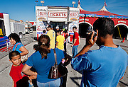 A crowd gathers in a mall parking lot in a suburb of Dallas, Texas, to buy tickets for the Carson & Barnes Circus, on Tuesday, March 24, 2009.