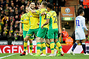 Norwich City midfielder Mario Vrancic (8) celebrates with Norwich City forward Teemu Pukki (22)  and Norwich City midfielder Kenny McLean (23) after scoring the second goal 2-0 during the EFL Sky Bet Championship match between Norwich City and Blackburn Rovers at Carrow Road, Norwich, England on 27 April 2019.