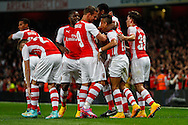 Alexis Sanchez of Arsenal (2nd right) celebrates scoring the opening goal against Southampton with team mates during the Capital One Cup match at the Emirates Stadium, London<br /> Picture by David Horn/Focus Images Ltd +44 7545 970036<br /> 23/09/2014
