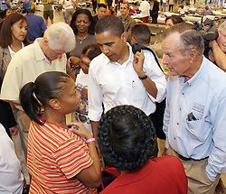 Former U.S. presidents Bill Cinton (L) and George Bush (R) and Sen. Barack Obama (C) visit with people at a shelter set up for Hurricane Katrina evacuees at the Astrodome in Houston, Texas, on Monday, September 5, 2005. Photo by Richard Carson/KRT/ABACAPRESS.COM.