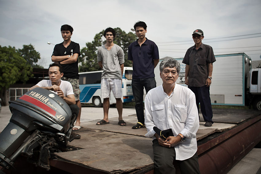 Mr Chetsarish Smithnukulkit with his crew at the VS Service warehouse, a Thai production company that assists Hollywood film crews with local shoots. During the 2011 flood they navigated the canals upstream rescuing as many people as they could on their way to bring help in the Ayutthaya province.