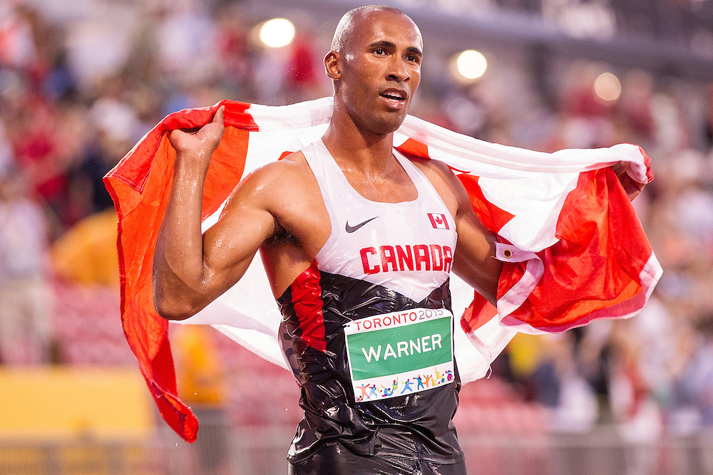 Damian Warner of Canada celebrates his gold medal win in the men's decathlon at CIBC Athletics Stadium at the at the 2015 Pan American Games in Toronto, Canada, July 23,  2015.  AFP PHOTO/GEOFF ROBINS