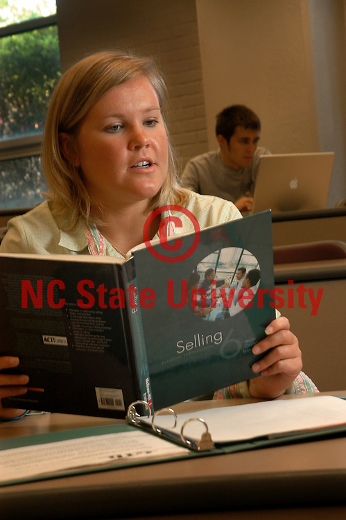 College of Management's Sarah Styron reads through her marketing text book before the beginning of class in Nelson Hall.   PHOTO BY ROGER WINSTEAD