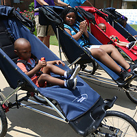 Karter Shannon, 3, participated in one of the many wheelchair races held Saturday at the Arc in the Park event at the Oren Dunn Museum