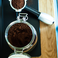 Glass jar of coffee powder, perspective from above