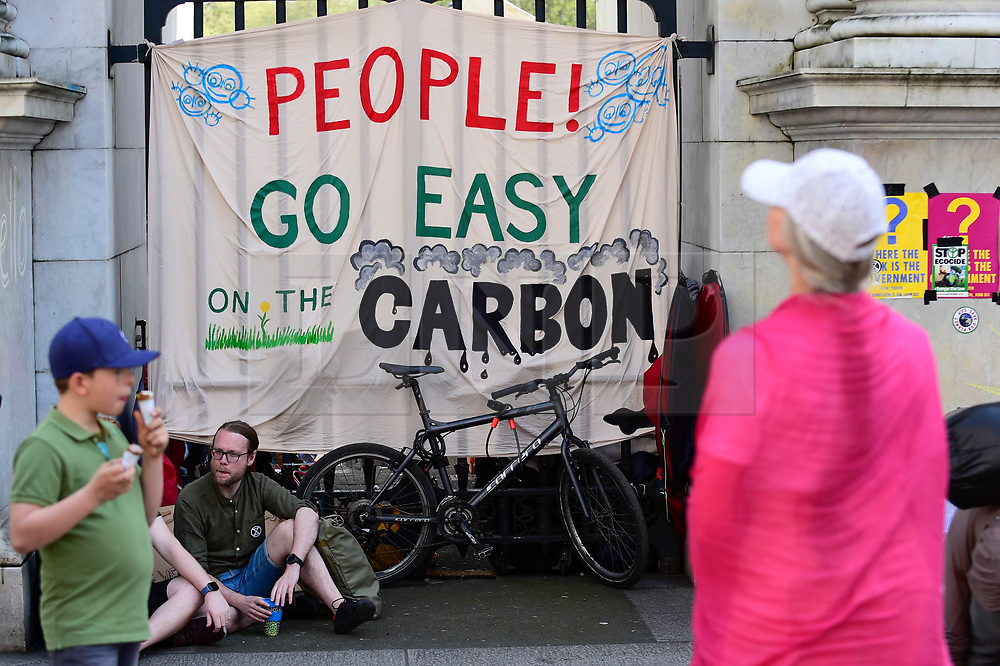 "© Licensed to London News Pictures. 22/04/2019. LONDON, UK.  A sign made by activists gathered at Marble Arch during ""London: International Rebellion"", on day eight of a protest organised by Extinction Rebellion.  Protesters are demanding that governments take action against climate change.  After police issued section 14 orders at the other protest sites of Oxford Circus, Waterloo Bridge and Parliament Square resulting in over 900 arrests, protesters have convened at the designated site of Marble Arch so that the protest can continue.  Photo credit: Stephen Chung/LNP"
