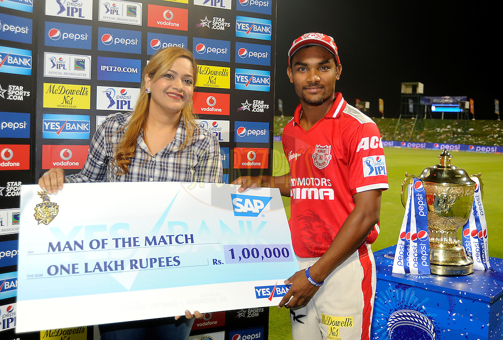 Sandeep Sharma of the Kings X1 Punjab receives the man of the match award  during the presentation after match 15 of the Pepsi Indian Premier League 2014 Season between The Kings XI Punjab and the Kolkata Knight Riders held at the Sheikh Zayed Stadium, Abu Dhabi, United Arab Emirates on the 26th April 2014<br /> <br /> Photo by Pal Pillai / IPL / SPORTZPICS