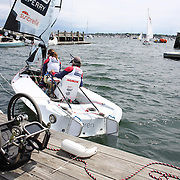 Skipper Sarah Everhart Skeels, (right), Tiverton, RI, and Cindy Walker, Middletown, RI, the only all female team competing in The Skud 18 class, leave the dock for competition with Sarah Everhart Skeels wheelchair on the dock during the C. Thomas Clagett, Jr. Memorial Clinic & Regatta at Newport, Rhode Island hosted by Sail Newport at Fort Adams. <br /> The Clagett is North America's premier event for sailors with disabilities with sailors competing in the 3 Paralympic class boats and is an integral part of preparation for athletes preparing for  Paralympic and world championship racing. Newport, Rhode Island, USA. 26th June 2015. Photo Tim Clayton