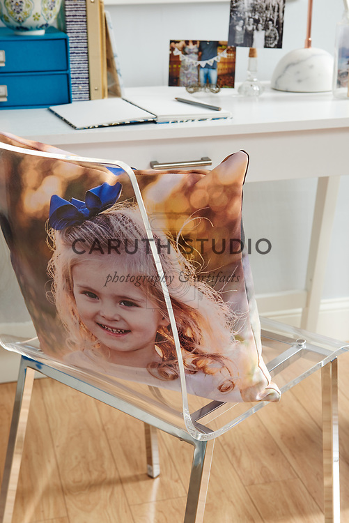 Photo fabric pillow on acrylic desk chair
