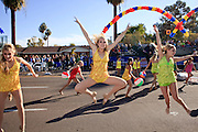 03 JANUARY 2009 -- PHOENIX, AZ: Dennielle Robbins (CQ), 13, center, and other members Desert West Dance Academy in Buckeye perform in the annual Ft. McDowell Fiesta Bowl parade through Phoenix, AZ. More than 150,000 spectators line the parade routes which starts in north Phoenix and winds down Central Ave and 7th Street before ending in central Phoenix. More than 100 units march in the parade.  PHOTO BY JACK KURTZ