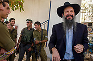 A Rabbi from the Hasidic Chabad movement performs magic tricks for Israeli soldiers who protect the Jewish community in Hebron. Some six hundred Jews live in the heart of Hebron's old city surrounded by over 160,000 Palestinian inhabitants.<br /> Hebron, Israel. 02/11/2007