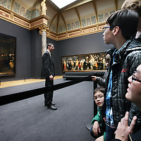 Nederland, Amsterdam , 13 april 2013.<br /> Openingsdag van het Rijksmuseum,<br /> De familie Linandi uit uithoorn bekijkt de Nachtwacht in de Rembrandtzaal.<br /> Amsterdam, 13 April 2013 Rijksmuseum opened after 10 years of renovation: the public could take a look at the museum for free. The Linandi family watches Rembrandt's Nightwatch.